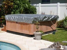 Hot tub, cover and lifter - all covered and protected by the spa cap