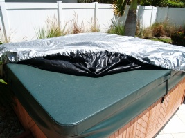 Pulling the spa cap over the corners of the hot tub cover