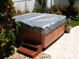 The spa cover is now protected from UV and elements by the spa cap