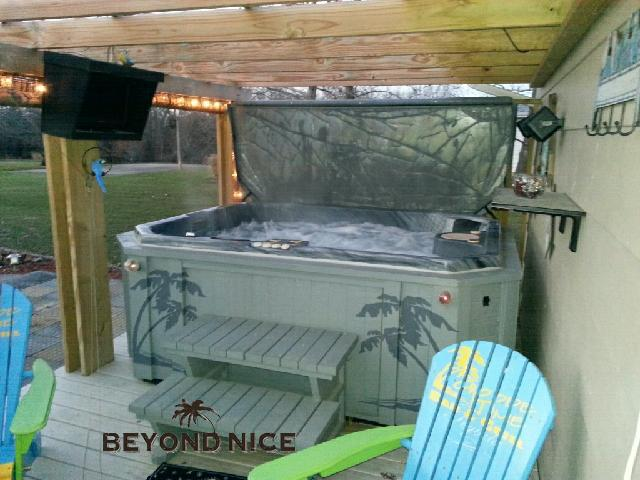 Hot tub spa cover lifter with cover in storage position while in use