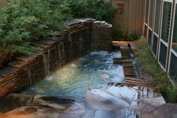 Custom, in ground, hot tub with waterfall